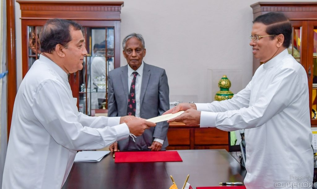 President's secretary Austin Fernando at the swearing in of new deputy and state ministers recently. His job seems to be safe only because no one else wants it.