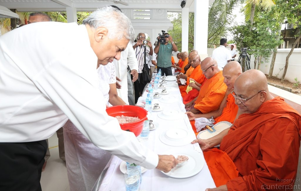 Prime Minister Ranil Wickremsinghe serving food to Buddhist priests recently. But former President Mahinda Rajapaksa is still the pre-eminent Sinhala Buddhist leader.
