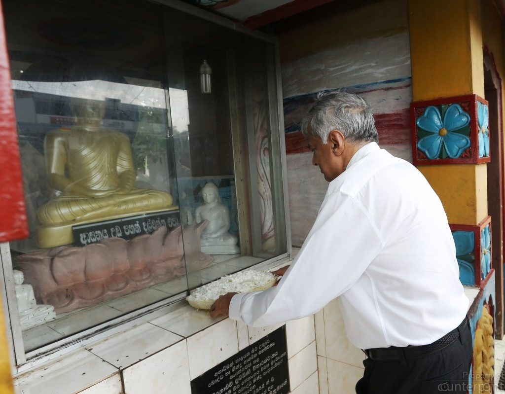 Prime Minister Wickremesinghe worshiping at a Buddhist temple recently. Unfortunately, he has never been able to win the confidence of a majority of the Sinhalese.