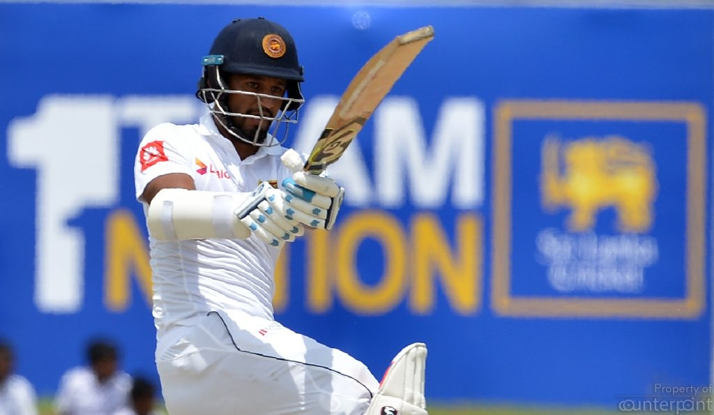 Sri Lankan opening batsman Dimuth Karunaratne pulling the ball for a boundary. He was the only batsman to flourish in both tests.