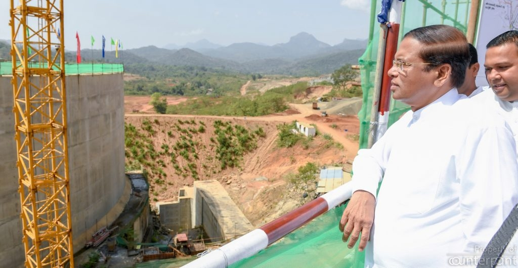 President Sirisena looking at the concrete dam across the Kalu Ganga. According to his acolytes, this is the greatest irrigation project in the history of this country.