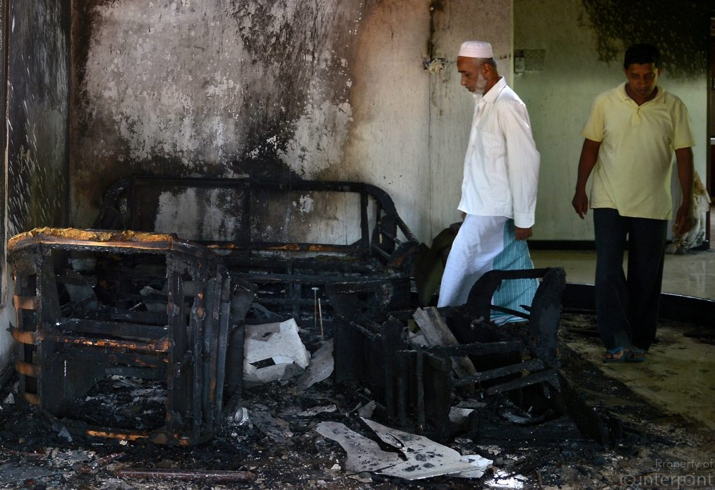 Two members of the Muslim community examine the remnants of their home following the Aluthgama riots of 2014. Minority groups, especially the Muslim community have been at the receiving end of violence and harassment, following the end of the 30 year ethnic clashes between the Sinhalese and the Tamils. The Rajapaksa government, for the most part ignored the anti-minority sentiments. The current government did no better, when violence erupted between Sinhalese and Muslims earlier this year in the Kandy area. Would legislation alone help change popular sentiments that seek to demonise the other?