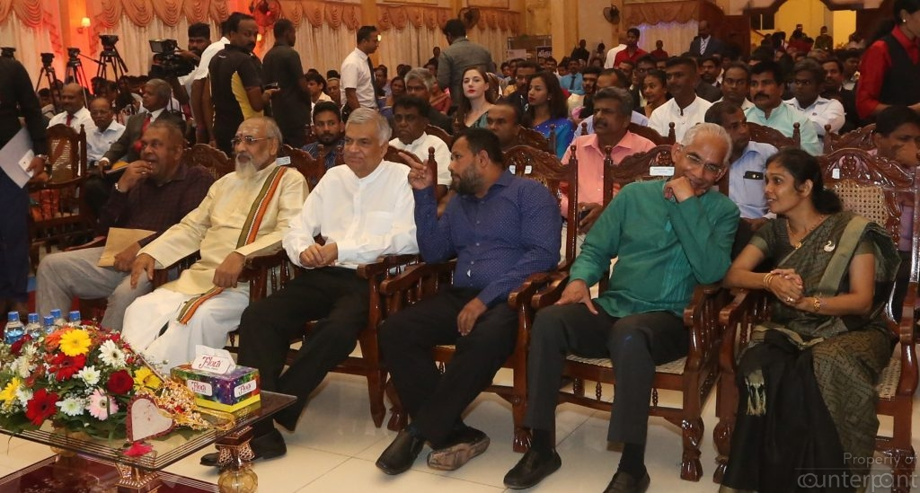 """Jaffna UNP parliamentarian Vijayakala Maheswaran at one end and Northern province Chief Minister Vigneshwaran on the other end of the row of VIPs at the launch of the """"Gamperaliya"""" development program in the North. Maheswaran recently resigned as Deputy Minister of Women and Child Affairs, and is under investigation, following a speech she made, where she called for the resurgence of the LTTE. Vigneshwaran is also taking more hardline positions on political issues amidst allegations he is being backed by pro LTTE diaspora groups."""