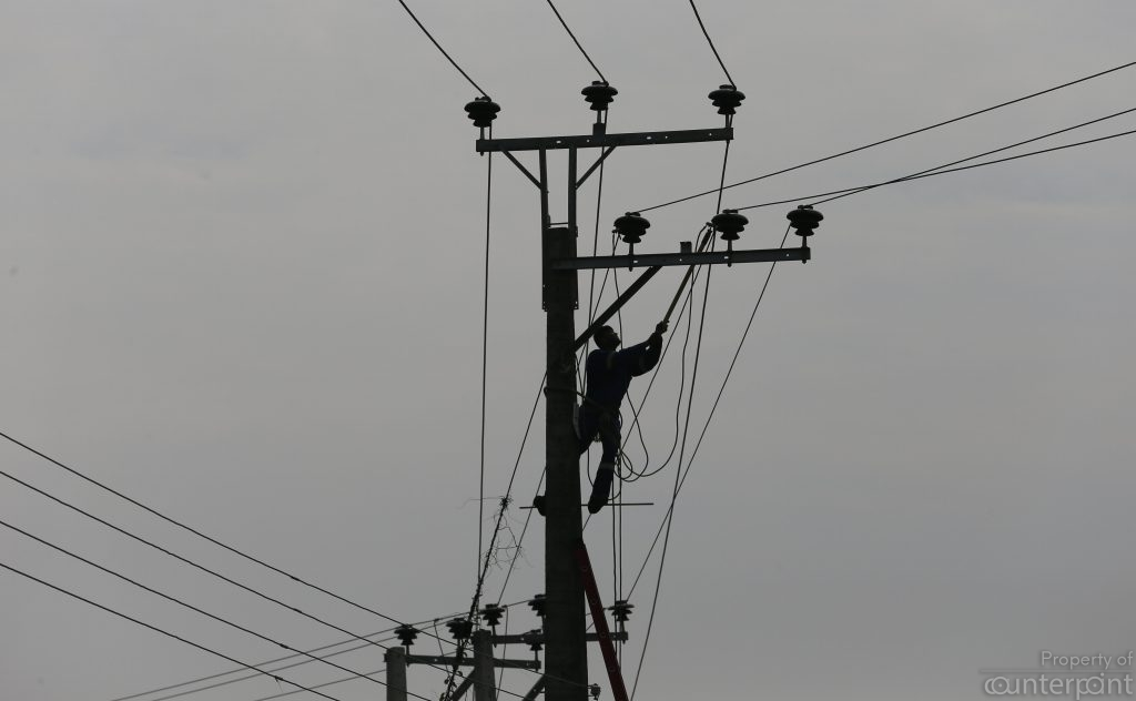 An electricity board lineman doing his high wire act. This is nothing compared to the decades long, superbly fine- tuned act by CEB officials and ministry bureaucrats, earning multi millions in kickbacks from the country's corrupt business tycoons.