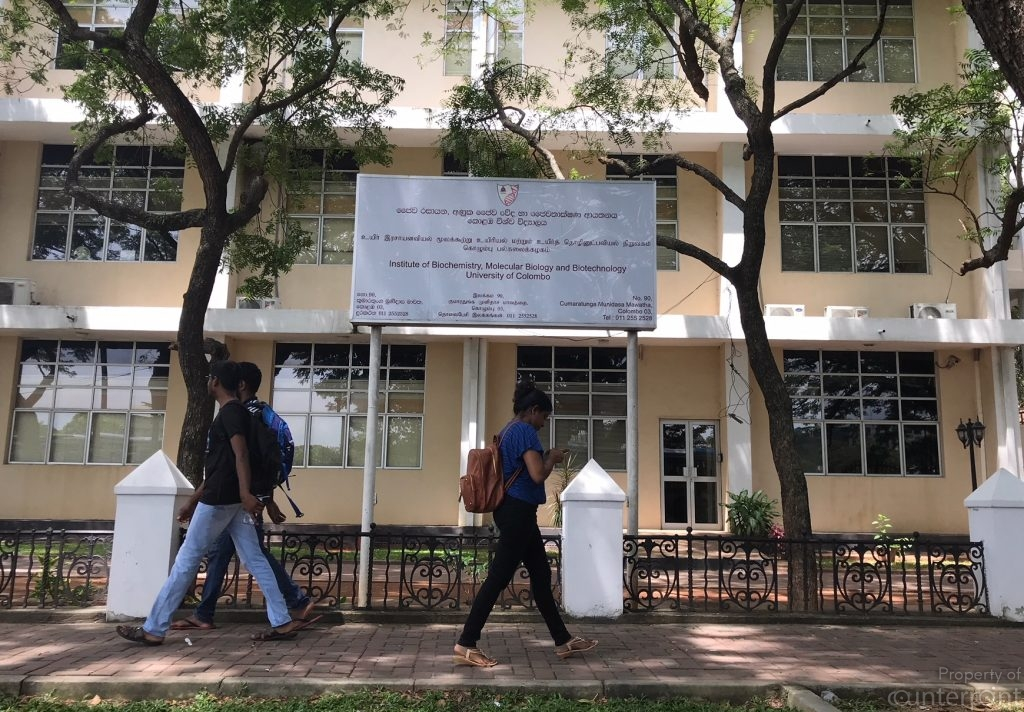 Students walk past one of the Colombo University buildings. Reform of the country's education system is a sore need, if graduates are to broaden their horizons.