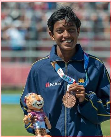 Paarami displays the medal she won.
