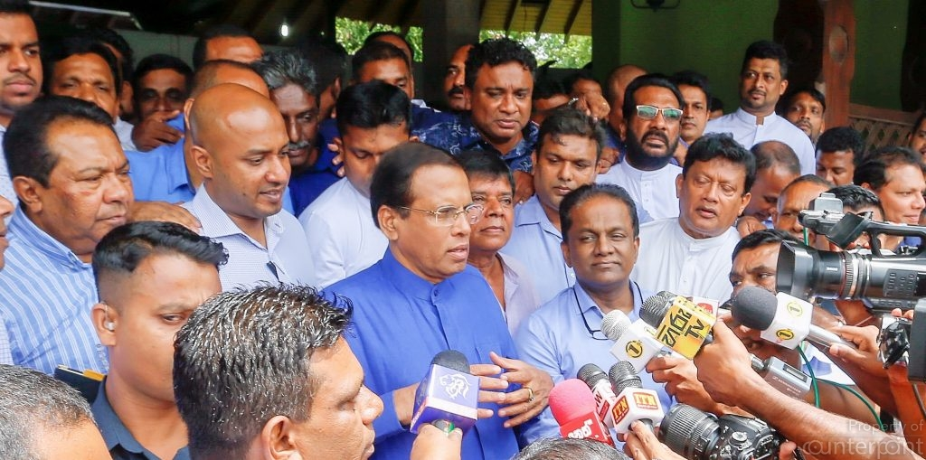 President Sirisena addressing the media after the General meeting of the Sri Lanka Freedom Party, which he leads now, after resting power from former President Rajapaksa. In the run-up to the 2015 Presidential polls Sirisena appealed for votes stating that a defeat would see him six feet under. He has now handed over government to those from whom he feared for his life only three years ago, accusing the UNP of plotting his assassination.