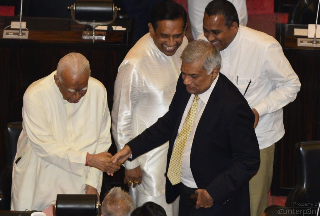 On Wednesday, December 12, a vote of confidence in Ranil Wikcremesinghe to function as Prime Minister was passed in parliament. The motion won the backing of the TNA. Picture shows Ranil Wickremesinghe and TNA Leader R Sambanthan in Parliament.