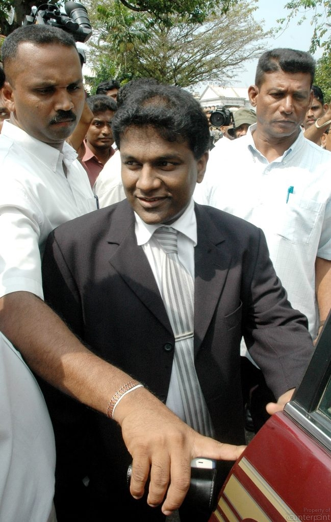 Thilanga Sumathipala leaves Sports Ministry premises after handing over his nominations to contest the 2003 cricket elections.
