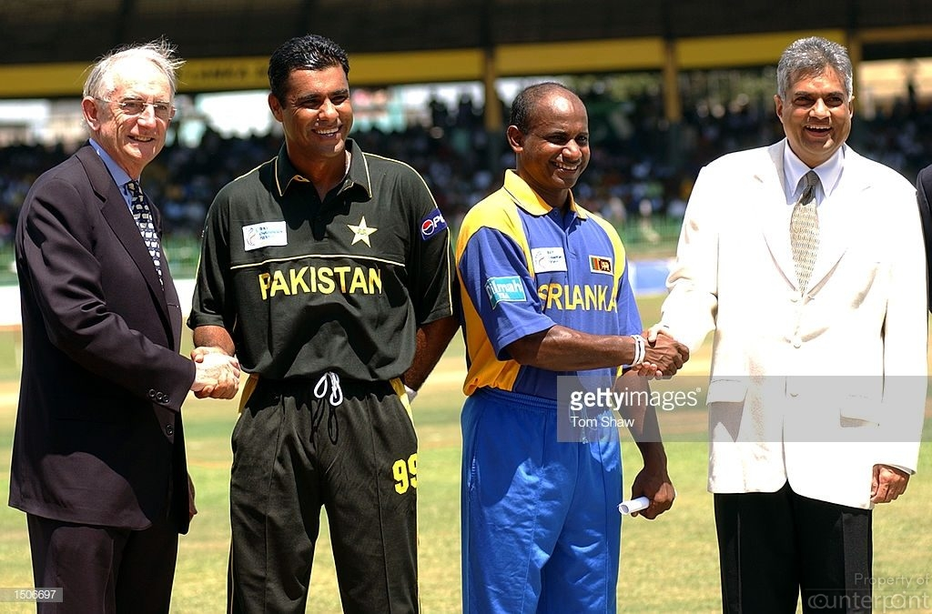 Prime Minister Ranil Wickremesinghe was present at the toss ahead of the curtain raiser of the Champions Trophy in 2002 in Colombo. He is seen alongside Pakistan skipper Waqar Younis and his Sri Lankan counterpart Sanath Jayasuriya. ICC Chief Malcolm Grey is also in the picture. Later that year Wickremesinghe ordered SLC Chairman Hemaka Amarasuriya to withdraw from the ICC Meetings and instead appointed outsider Thilanga Sumathipala to attend ICC Meetings.