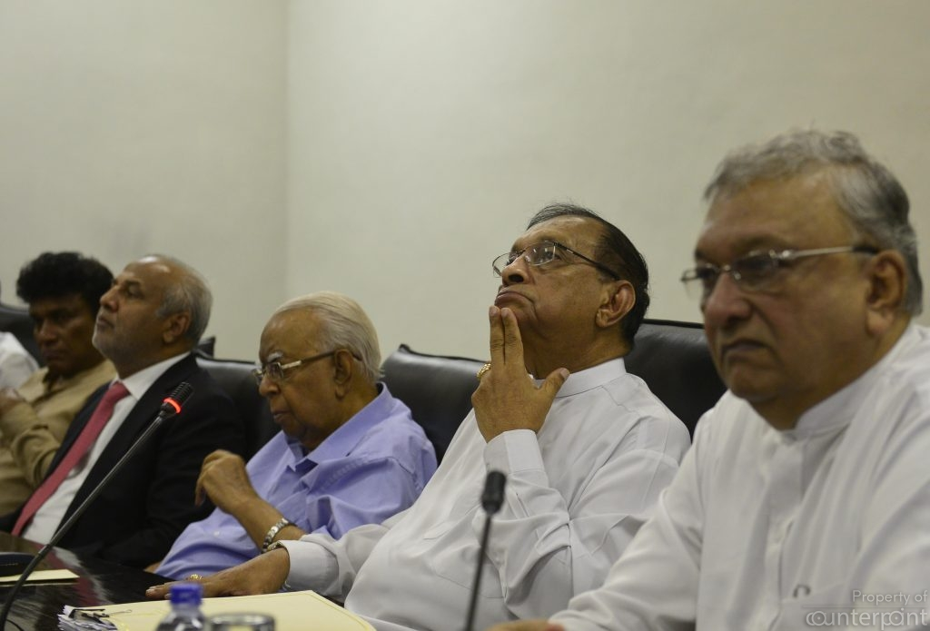 R. Sampanthan, (in blue shirt), has lost the position of Opposition Leader.