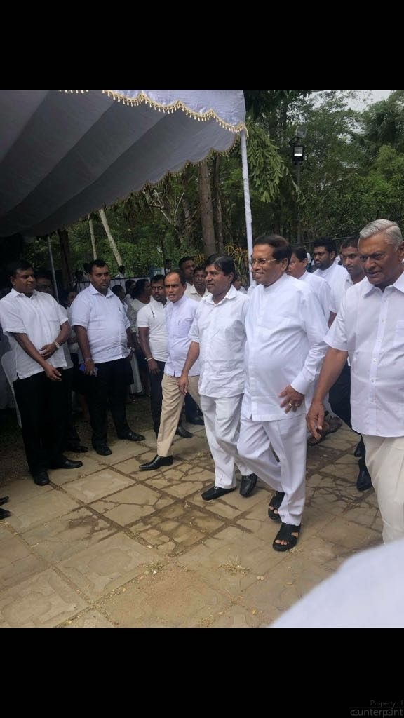 President Sirisena desperately wants a second term. He is seen at the funeral of one the Rajapaksa brothers.