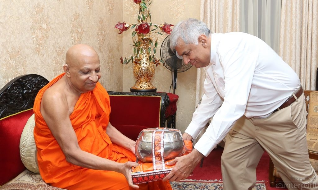 It has become a tradition in Sri Lanka, for all politicians to visit the Heads of the main Buddhist Temples, whenever they take office, and during other important events. Buddhist religious leaders weild much influence over political leaders in the country. Seen here, is Prime Minister Ranil Wickremasinghe with the Ven. Thibbatuwawe Sri Siddhartha Sumangala Thero, the Head of the Malwatte Chapter.
