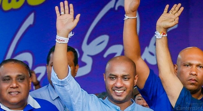 The SLFP's Duminda Dissanayake (center) has no love for the Rajapaksa's and helped endorse President Sirisena as his party's Presidential nominee. But his loyalties lie with former President Chandrika Kumaratunga, who is currently more supportive of the UNP.