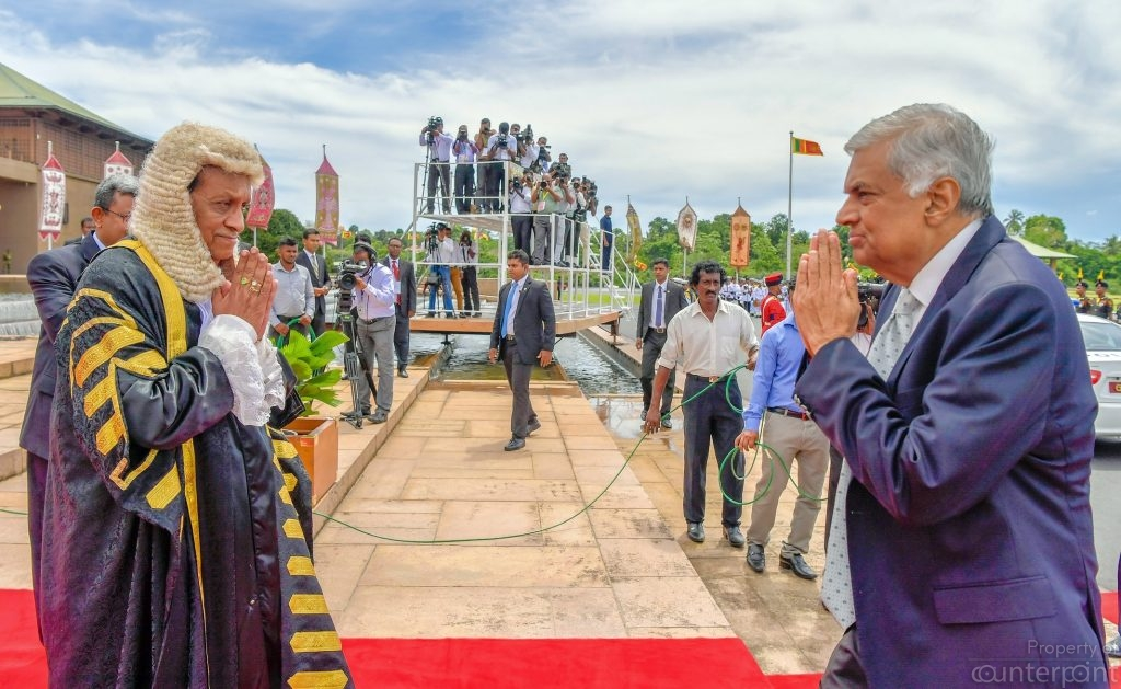 Prime Minister Ranil Wickremasinghe being greeted at Parliament by Speaker Karu Jayasuriya. It's an uphill task for Wickremasinghe and the UNP to win the votes of the rural population. Would Jayasuriya be a safer bet?