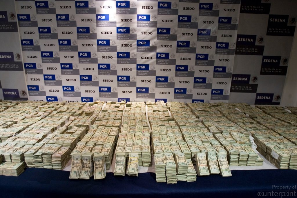 The pile of cash seized by the Mexican army from a drug cartel in 2016.