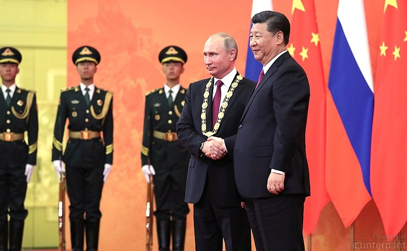 The Order of Friendship of the People's Republic of China was awarded to Vladimir Putin by President of China Xi Jinping. President Putin is the first foreign leader to receive this high national order of China. (photo courtesy http://en.kremlin.ru/events/president/news/57701)