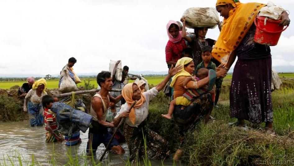Myanmar's Rohingiya community, seen here crossing over to Bangladesh. (Courtesy Human Rights Watch)