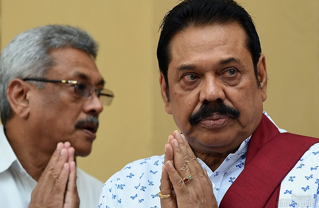 Will he or won't he? Former Defence Secretary Gotabaya Rajapaksa (left) has made no bones about wanting the presidency, but brother, former President Mahinda Rajapaksa (right) is yet to give his blessings.