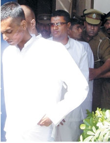 One of the two underworld figures still amongst the living, Nauffer was convicted for the murder of Judge Ambepitiya and his bodyguard.