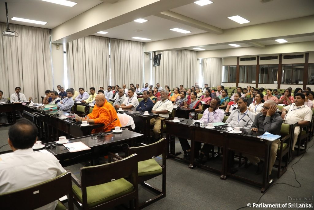 Health and Education officials and other stakeholders at the January 9 meeting. (courtesy parliament media).