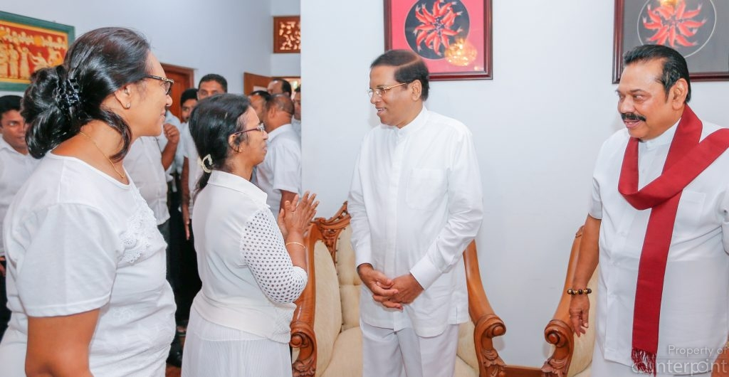 Maithripala Sirisena began mending fences with the Rajapaksa's around the time the Rajapaksa family lost a sibling. Photo shows Sirisena(left) with Mahinda Rajapaksa (right) and other family members at the funeral.